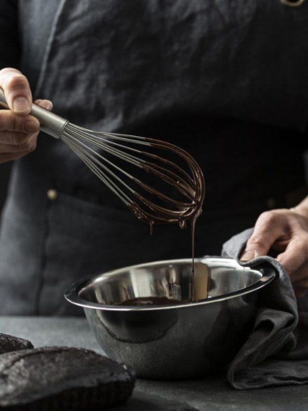 front-view-chef-preparing-chocolate-cake